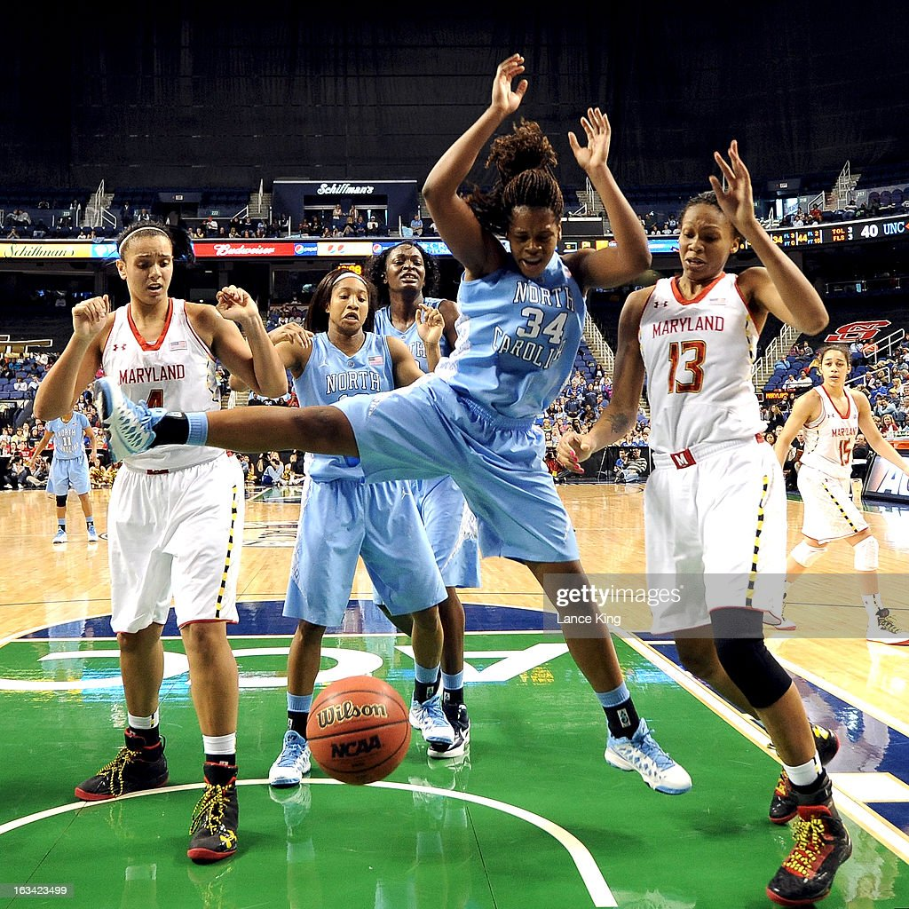 Xylina McDaniel #34 of the North Carolina Tar Heels and Alicia DeVaughn #13 of the Maryland Terrapins fight for a loose ball during the semifinals of the 2013 Women's ACC Tournament at the Greensboro Coliseum on March 9, 2013 in Greensboro, North Carolina.