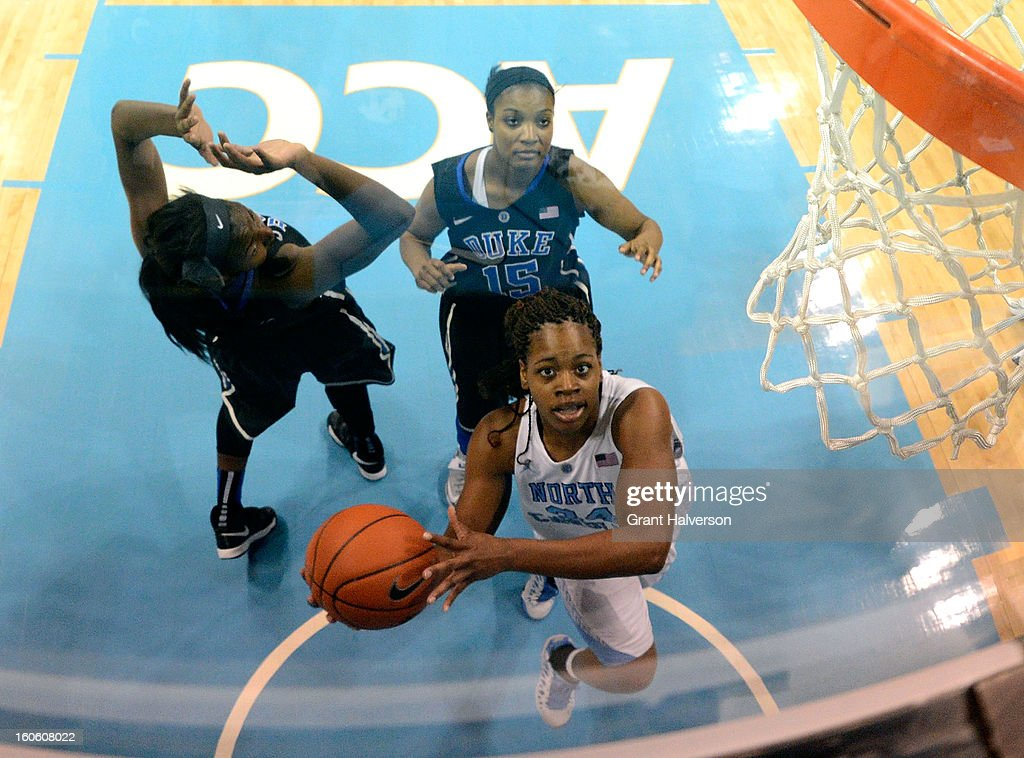 Xylina McDaniel #34 of the North Carolina Tar Heels drives past Richa Jackson #15 of the Duke Blue Devils during play at Carmichael Arena on February 3, 2013 in Chapel Hill, North Carolina. Duke won 84-63.