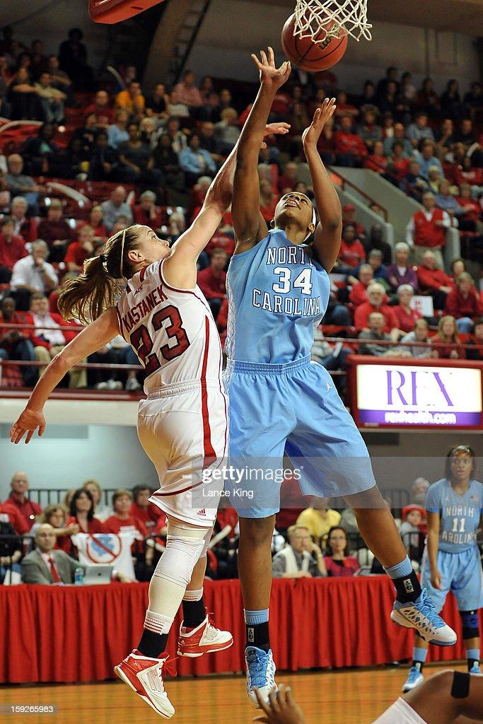 Xylina McDaniel #34 of the North Carolina Tar Heels puts up a shot against Marissa Kastanek #23 of the North Carolina State Wolfpack at Reynolds Coliseum on January 10, 2013 in Raleigh, North Carolina.