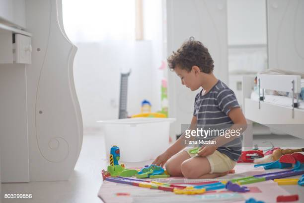 4 y old boy playing in his room