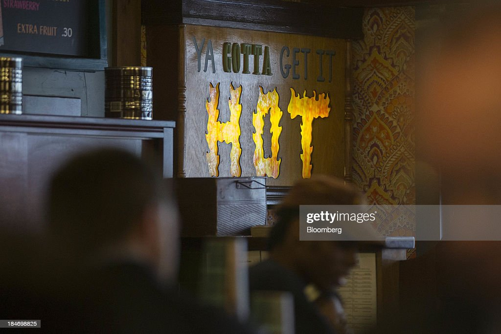 A 'Ya gotta get it hot' sign hangs inside a Potbelly Sandwich Shop in Washington, D.C., U.S., on Tuesday, Oct. 15, 2013. Potbelly Corp., the Chicago-based purveyor of made-to-order toasted sandwiches, held its initial public offering (IPO) on Oct. 4. Photographer: Andrew Harrer/Bloomberg via Getty Images