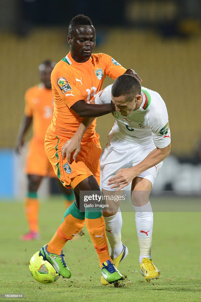 Ya Konan of Ivory Coast and <a gi-track='captionPersonalityLinkClicked' href=/galleries/search?phrase=Djamel+Mesbah&family=editorial&specificpeople=6693283 ng-click='$event.stopPropagation()'>Djamel Mesbah</a> of Algeria during the 2013 African Cup of Nations match between Algeria and Ivory Coast at Royal Bafokeng Stadium on January 30, 2013 in Rustenburg, South Africa.