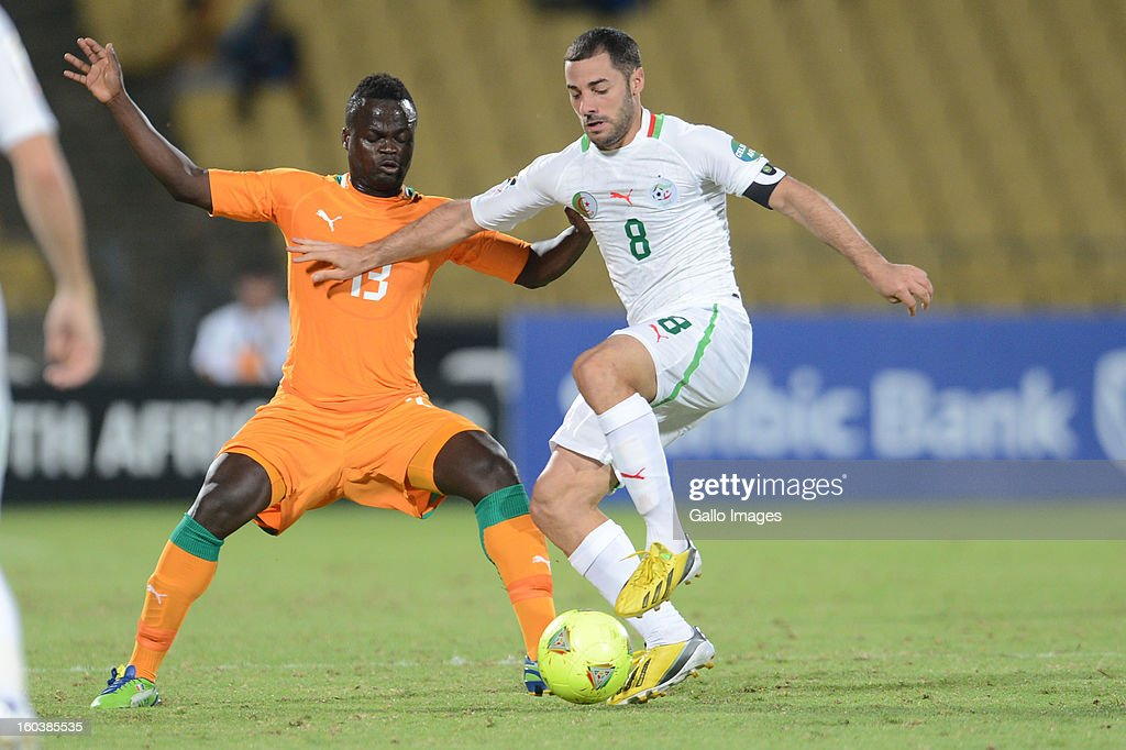 Ya Konan of Ivory Coast and <a gi-track='captionPersonalityLinkClicked' href=/galleries/search?phrase=Medhi+Lacen&family=editorial&specificpeople=5550187 ng-click='$event.stopPropagation()'>Medhi Lacen</a> of Algeria during the 2013 African Cup of Nations match between Algeria and Ivory Coast at Royal Bafokeng Stadium on January 30, 2013 in Rustenburg, South Africa.