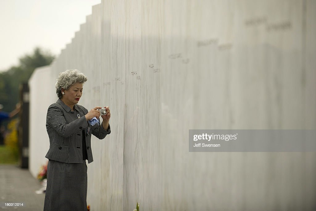 Yachiyo Kuge, mother of victim Toshiya Kuge, pauses at her sonr's name at the Flight 93 National Memorial during ceremonies commemorating the 12th anniversary of the 9/11 attacks on September 11, 2013 in Shanksville, Pennsylvania. The nation is commemorating the anniversary of the 2001 attacks, which resulted in the deaths of nearly 3,000 people after two hijacked planes crashed into the World Trade Center, one into the Pentagon in Arlington, Virginia and one crash landed in Shanksville, Pennsylvania.