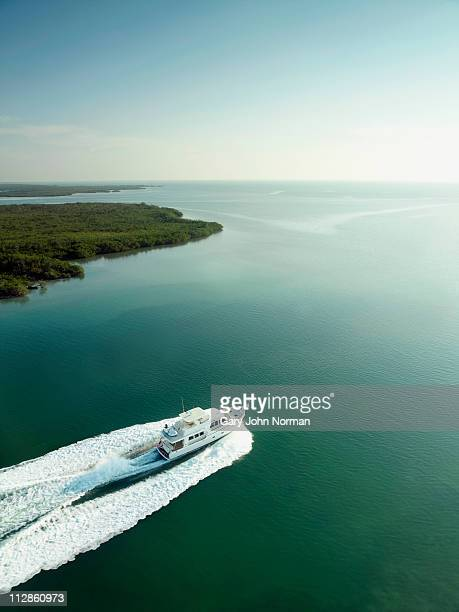Yacht aerial view moves through water