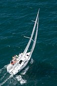 Yacht competes in team sailing event, California, aerial view