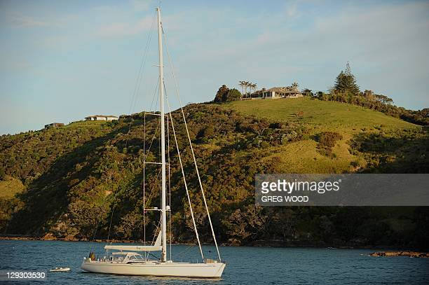 A yacht motors out from Waiheke Island in the Hauraki Gulf near Auckland as the 2011 Rugby World Cup is held on October 14 2011 Waiheke Island is a...