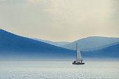 Yacht on the foggy lake