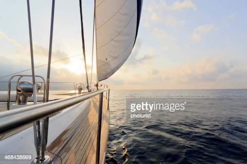 Yacht sailing at sunset : Stock Photo