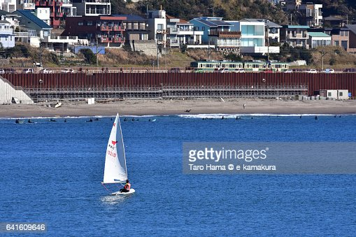 A yacht sailing on the beach and a running train