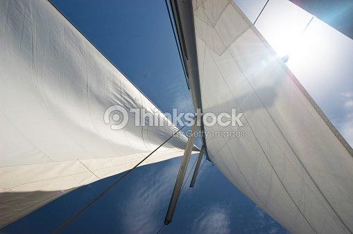 Yacht Sails Against Blue Sky Stock Photo | Thinkstock