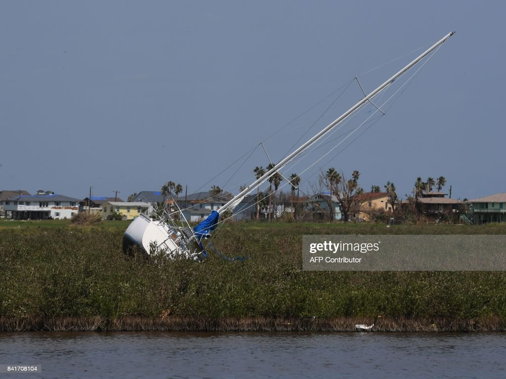TOPSHOT - A yacht that was washed up onto dry land after Hurricane Harvey caused widespread destruction in Rockport, Texas on September 1, 2017. /