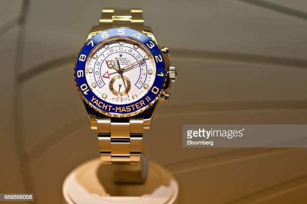 A YachtMaster II model luxury wristwatch produced by Rolex SA stands on display during the 2017 Baselworld luxury watch and jewelry fair in Basel...