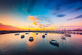Yachts anchored in a row at St. Kilda beach at sunset, Victoria, Australia