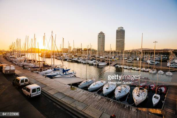 Yachts and boats moored at Port Olimpic in Barcelona, Spain