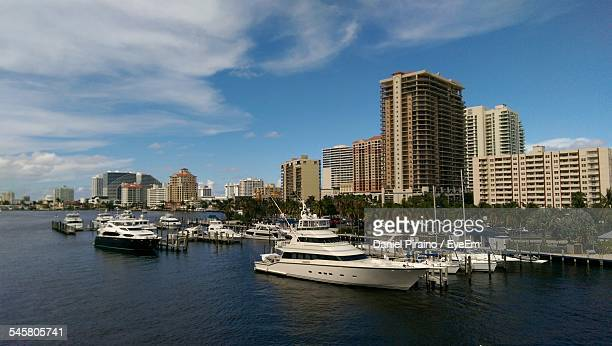 Yachts In River Against Buildings In City