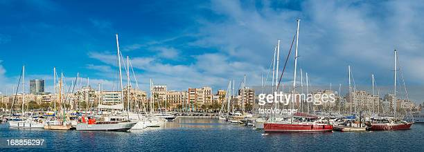 Yachts moored in Mediterranean harbour marina Barcelona Spain