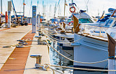 Sailing boats moored at the pier in Portocolom on Mallorca, Spain Balearic islands