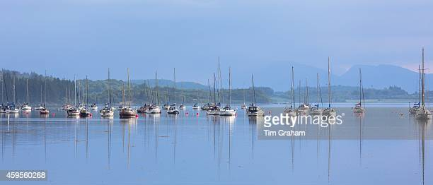 Yachts moored on Loch Creran making reflections on the sea loch on west coast of Scotland near Creagan in the Argyll and Bute region