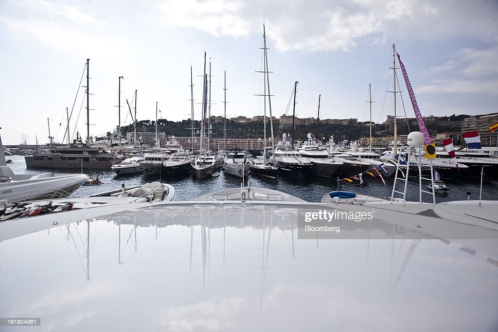 Yachts sit moored in the harbor during the Monaco Yacht Show (MYS) in Monaco, France, on Thursday, Sept. 26, 2013. Over 100 of the world's luxury yachts will be displayed in Port Hercules during the 23rd MYS which runs from Sept. 25 - 28. Photographer: Balint Porneczi/Bloomberg via Getty Images