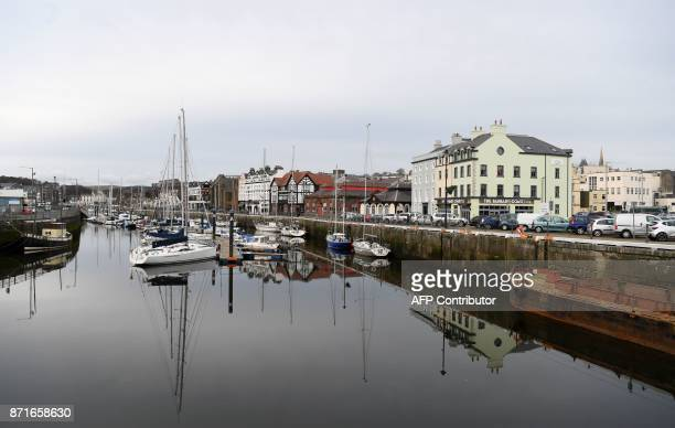 Yachts sit moored in the harbour in Douglas on the Isle of Man an island in the Irish Sea off of the west coast England on November 8 2017 The Isle...
