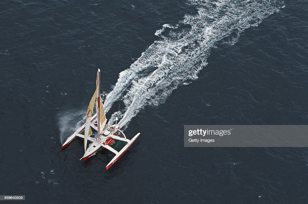 Yachtsmen Peter Blake and Mike Quilter of New Zealand sail the Steinlager 1 trimaran racer across the Pacific Ocean during the Bicentennial TwoHanded...