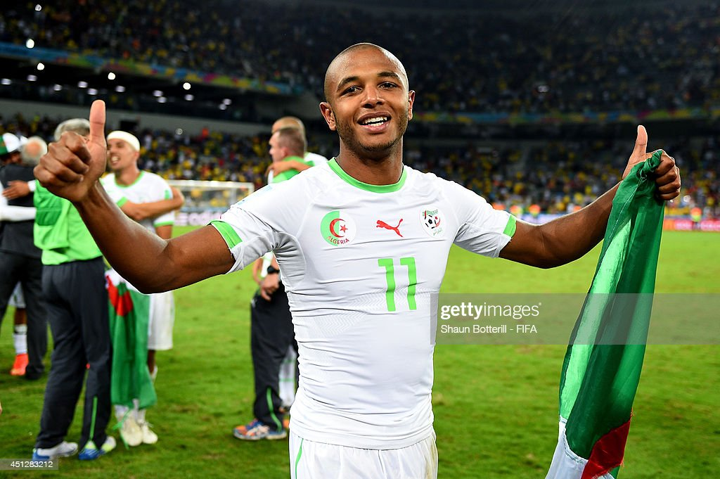 <a gi-track='captionPersonalityLinkClicked' href=/galleries/search?phrase=Yacine+Brahimi&family=editorial&specificpeople=7111395 ng-click='$event.stopPropagation()'>Yacine Brahimi</a> of Algeria celebrates qualifying for the knock out stage after the 1-1 draw in the 2014 FIFA World Cup Brazil Group H match between Algeria and Russia at Arena da Baixada on June 26, 2014 in Curitiba, Brazil.
