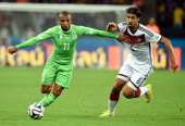 Yacine Brahimi of Algeria controls the ball against Sami Khedira of Germany during the 2014 FIFA World Cup Brazil Round of 16 match between Germany...