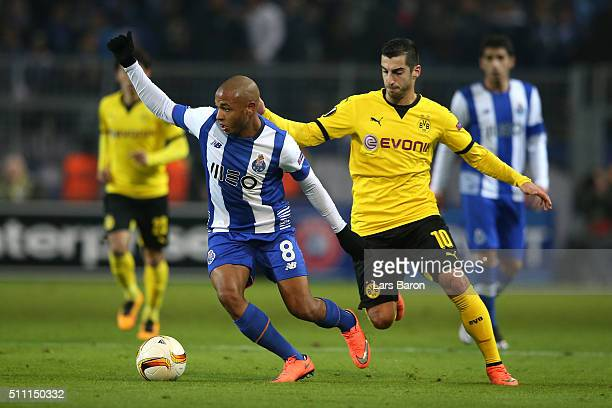 Yacine Brahimi of FC Porto and Henrikh Mkhitaryan of Borussia Dortmund compete for the ball during the UEFA Europa League round of 32 first leg match...