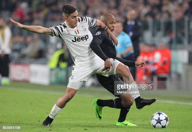 Yacine Brahimi of FC Porto competes for the ball with Paulo Dybala of Juventus FC during the UEFA Champions League Round of 16 second leg match...