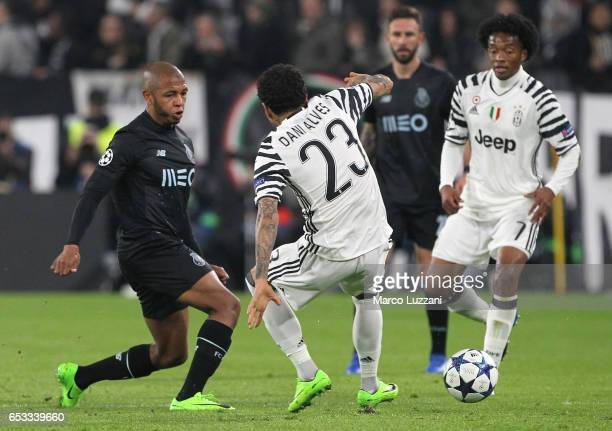 Yacine Brahimi of FC Porto is challenged by Daniel Alves da Silva of Juventus FC during the UEFA Champions League Round of 16 second leg match...