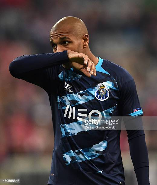 Yacine Brahimi of FC Porto wipes his face during the UEFA Champions League Quarter Final Second Leg match between FC Bayern Muenchen and FC Porto at...