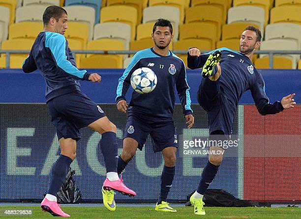Yacine Brahimi vies for the ball with Jesus Corona and Miguel Layun of FC Porto during a training session at the Olimpiysky stadium in Kiev on...
