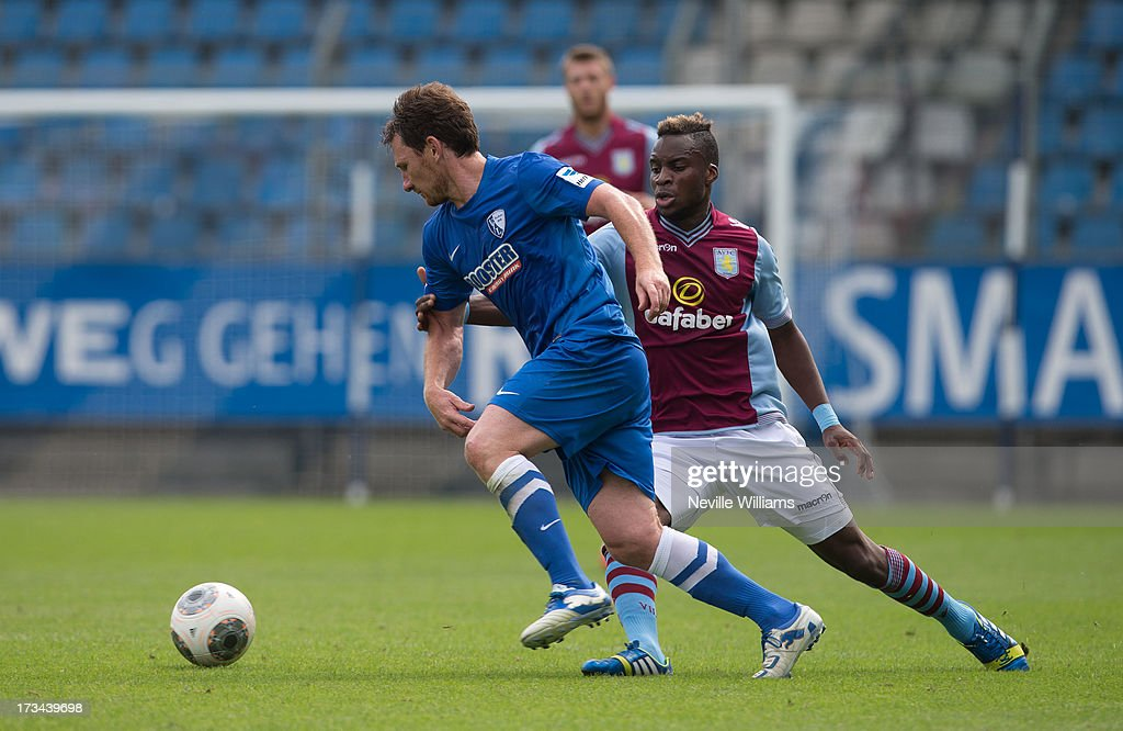 Yacouba Sylla of Aston Villa challenges Piotr Cwielong of Vfl Bochum during the Pre Season Friendly match between VfL Bochum and Aston Villa at Rewirpower Stadion on July 14, 2013 in Bochum, Germany.