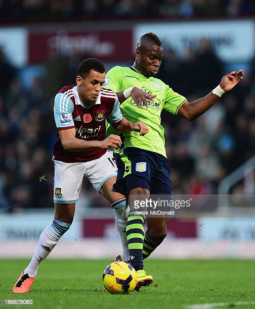 Yacouba Sylla of Aston Villa challenges Ravel Morrison of West Ham United during the Barclays Premier League match between West Ham United and Aston...
