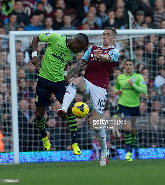 Yacouba Sylla of Aston Villa is challenged by Jack Collison of West Ham United during the Barclays Premier League match between West Ham United and...