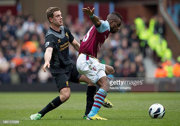 Yacouba Sylla of Aston Villa is challenged by Jordan Henderson of Liverpool during the Barclays Premier League match between Aston Villa and...