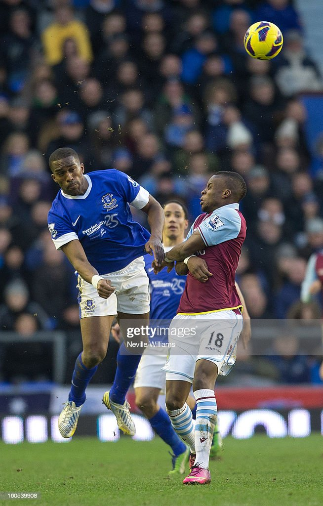 Yacouba Sylla of Aston Villa is challenged by Sylvain Distin of Everton during the Barclays Premier League match between Everton and Aston Villa at Goodison Park on February 02, 2013 in Liverpool, England.