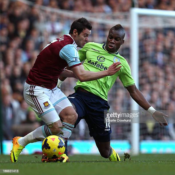 Yacouba Sylla of Villa puts a tough tackle in on West Ham's Matt Jarvis during the Barclays Premier League match between West Ham United and Aston...
