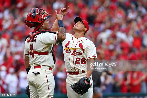 Yadier Molina and Seung Hwan Oh of the St Louis Cardinals celebrate after beating the Pittsburgh Pirates at Busch Stadium on October 1 2016 in St...