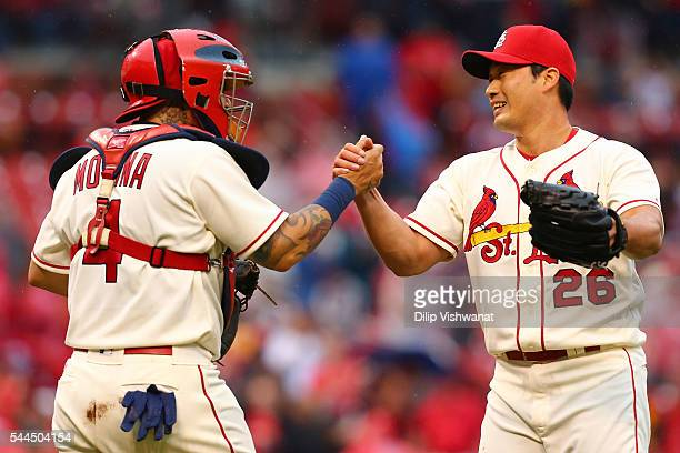 Yadier Molina and Seung Hwan Oh of the St Louis Cardinals congratulate each other after beating the Milwaukee Brewers at Busch Stadium on July 2 2016...