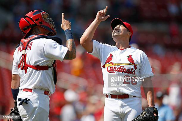 Yadier Molina and Seung Hwan Oh of the St Louis Cardinals point skyward as they celebrate the Cardinals 42 win against the San Diego Padres during...