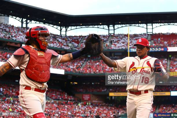 Yadier Molina and starter Carlos Martinez of the St Louis Cardinals congratulate each other after the second inning against the San Francisco Giants...