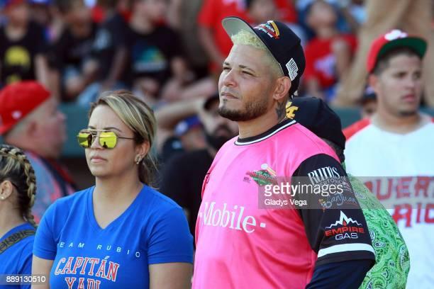 Yadier Molina and wife Wanda Torres participates to the aperture ceremony of Yadier Molina Celebrity Softball Game at Hiram Bithorn Stadium on...