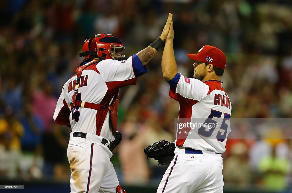 Yadier Molina #4 and Xavier Cedeno #55 celebrate a 3-0 win of Puerto Rico against Spain during the first round of the World Baseball Classic at Hiram Bithorn Stadium on March 8, 2013 in San Juan, Puerto Rico.