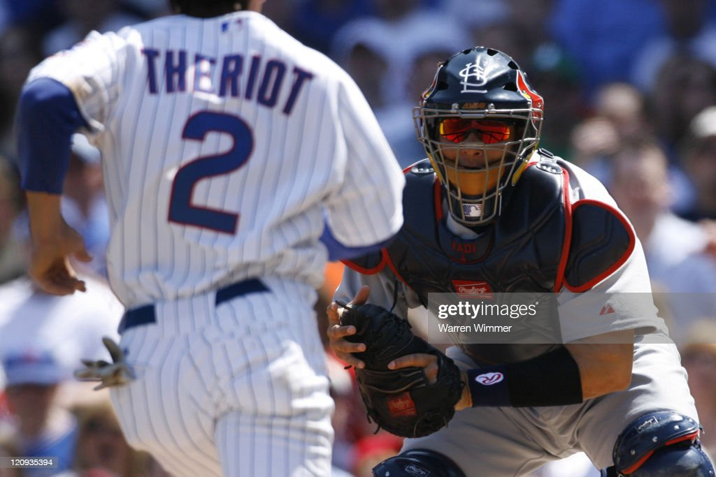 Yadier Molina, catcher of the St Louis Cardinals, waits to put the tag on a charging Ryan Theriot of the Cubs, at Wrigley Field, Chicago, Illinois, April 22, 2007. A full house of 40000 + fans watched the Chicago Cubs fall to the Saint Louis Cardinals by a score of 12 to 9, in 10 innings.