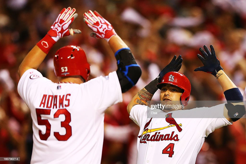 <a gi-track='captionPersonalityLinkClicked' href=/galleries/search?phrase=Yadier+Molina&family=editorial&specificpeople=172002 ng-click='$event.stopPropagation()'>Yadier Molina</a> #4 congratulates Matt Adams #53 of the St. Louis Cardinals on his two-run home run in the eighth inning against the Pittsburgh Pirates during Game Five of the National League Division Series at Busch Stadium on October 9, 2013 in St Louis, Missouri.