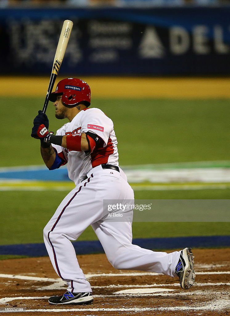 Yadier Molina #4 gets a hit of Puerto Rico against Spain during the first round of the World Baseball Classic at Hiram Bithorn Stadium on March 8, 2013 in San Juan, Puerto Rico.