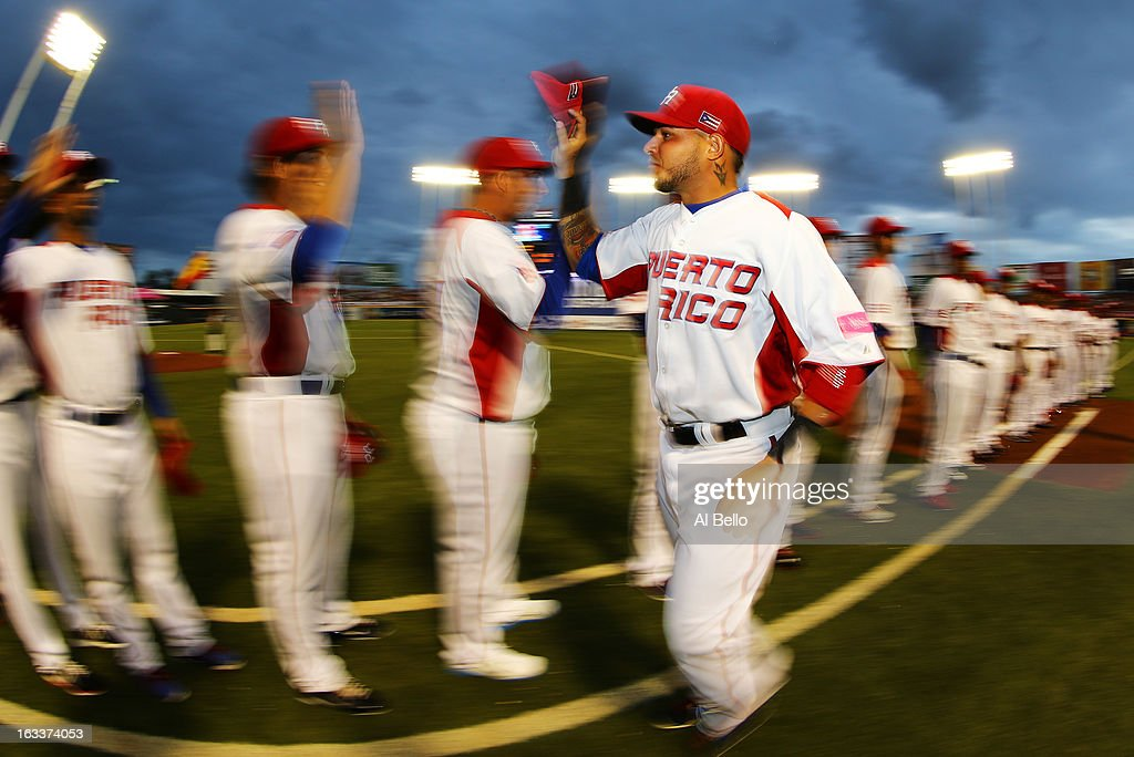 Yadier Molina #4 of Puerto Rico greets his teamates before the game against Spain during the first round of the World Baseball Classic at Hiram Bithorn Stadium on March 8, 2013 in San Juan, Puerto Rico.
