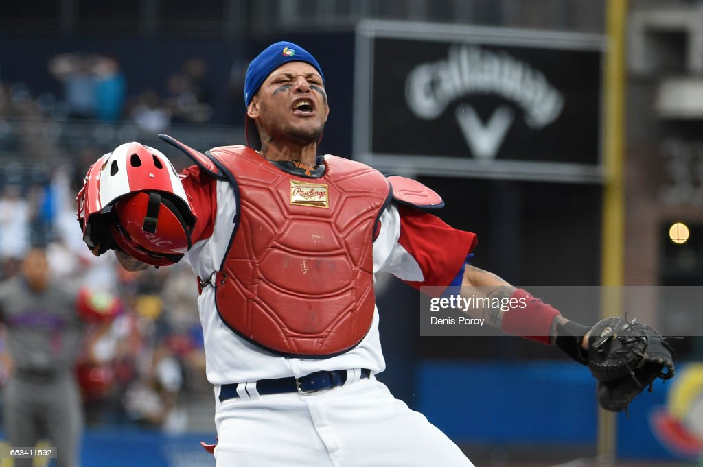 Yadier Molina #4 of Puerto Rico reacts after tagging Jean Segura #2 of the Dominican Republic out at the plate during the first inning of World Baseball Classic Pool F Game One between the Dominican Republic and Puerto Rico at PETCO Park on March 14, 2017 in San Diego, California.